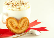 Cake in the form of heart with red ribbon Stock Image