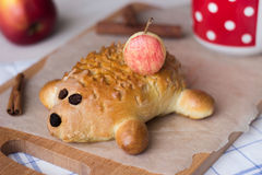 Cake in the form of a hedgehog. Breakfast consist of a cake in the form of a hedgehog with apples Stock Photo