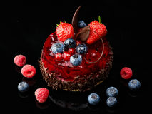 Cake with fresh berries and chocolate Stock Photography