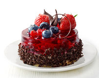 Cake with fresh berries and chocolate Stock Photos