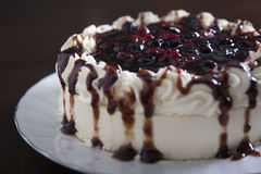 Cake with fresh berries and cream, closeup. Royalty Free Stock Images