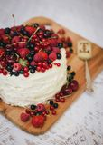 Cake with fresh berries and white glaze Stock Image