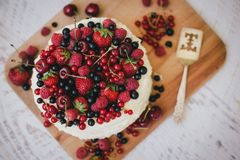 Cake with fresh berries and white glaze Stock Photos