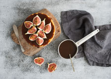 Cake with fresh figs and salted caramel on wooden Royalty Free Stock Photo
