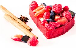 Cake with fresh forest berries with cinnamon and anise. Delicious cake with fresh forest berries with cinnamon and anise stock images