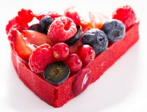 Cake with fresh forest berries. Delicious cake with fresh forest berries stock photos