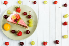 Cake with fresh fruits, copy space and selective focus Royalty Free Stock Photo
