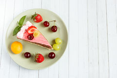 Cake with fresh fruits, copy space and selective focus Royalty Free Stock Photography