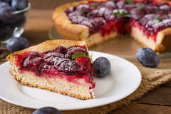 Cake with fresh plums and raspberries. Stock Photo