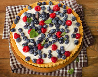 Cake with  fresh raspberries and blueberries. Top view Royalty Free Stock Image