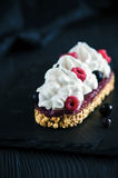 Cake with fresh raspberries. And currants and vanilla Chantilly cream Royalty Free Stock Image