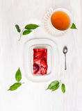 Cake with fresh strawberries and  cup of tea Stock Photography