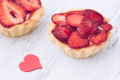 Cake with fresh strawberries and red heart Stock Photography