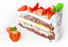 Cake with fresh whipped cream and strawberries Stock Images