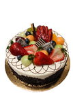 Cake with Fruit. A black forest cake topped with all kinds of different fruit Royalty Free Stock Images