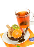 Cake with fruit and a cup of tea Stock Photos