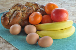 Cake, fruit and eggs Stock Images