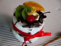 Cake. The Fruit Cake with orange, Kiwi and Cherry Stock Images