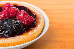 Cake with fruit on a plate. Close-up Stock Photo