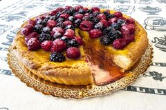 Cake, fruit tart covered in raspberries and blackberries. stock photo