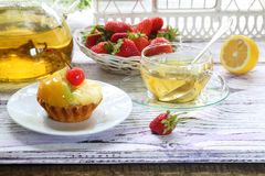 Cake with fruit and tea with a lemon in a transparent cup Royalty Free Stock Images