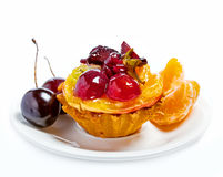 Cake and fruits. Sweet fruit cake isolated on white Royalty Free Stock Images