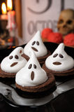 Cake ghosts for Halloween. Chocolate biscuits decorated with meringue as a ghost for Halloween Royalty Free Stock Photography