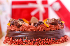 Cake and gift boxes Stock Photography