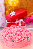 Cake and gift boxes Royalty Free Stock Images