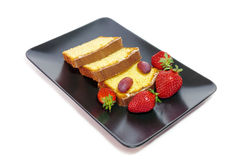 Cake with glaze of chocolate and strawberries  in the black dish Stock Images