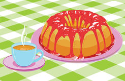 Cake with glaze and a cup of hot drink Royalty Free Stock Photography