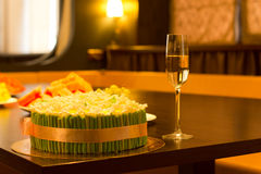 Cake with green and gold decoration with champagne Royalty Free Stock Photo