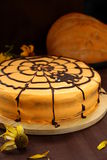 Cake for Halloween. Orange cake with cobwebs and pumpkins for Halloween stock images