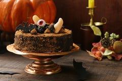 Cake with halloween decor. Super chocolate cake with halloween decor royalty free stock images