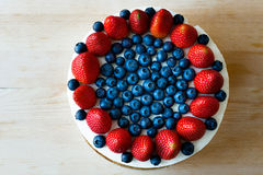 Cake handmade, decorated with blueberries and strawberries. Royalty Free Stock Photography