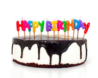 Cake with happy birthday candles royalty free stock image