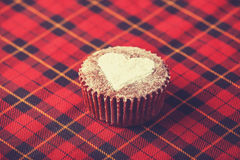 Cake with heart on fabric. Royalty Free Stock Photos