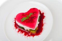 Cake heart shape. On plate stock photography