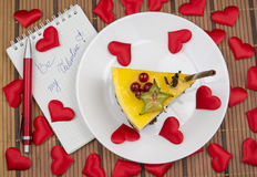 Cake and hearts love confession. Cake and red hearts written love confession Royalty Free Stock Photography