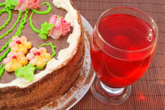 Cake and home-made juice. Cake with flower decoration and home-made juice Stock Image