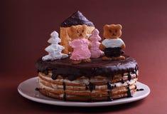 Cake honey cake decorated with figures Stock Photo