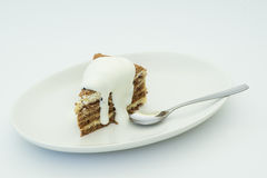 Cake. Honey cake on white plate and spoon Royalty Free Stock Photo