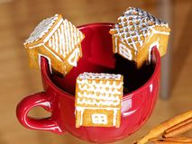 Cake houses hanging on the cup Stock Image