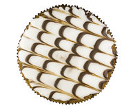 Cake with icing. Fancy cake with curvy icing, top view, isolated on white stock photo