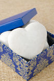 Cake with icing in the form of heart in a gift box, selective fo Stock Images