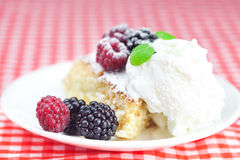 Cake with icing,icecream and berries Stock Photo