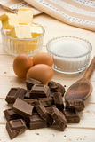 Cake Ingredients. Chocolate Cake Ingredients on pine wood table Stock Image