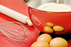 Cake ingredients and confectioner utensils Stock Images