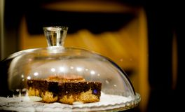 Cake inside a glass bowl in the pastry shop. No people stock images