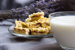 Cake with jam with cup of milk and lavender. Royalty Free Stock Photography